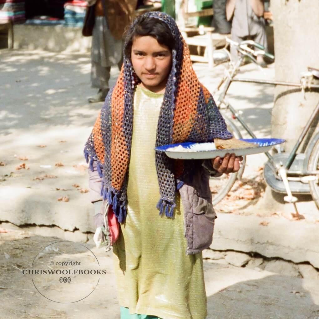 A girl going to market, Taloqan, Nov 1991.)